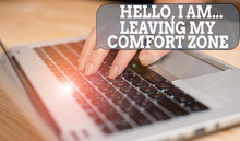 Writing Note Showing Hello I Am Leaving My Comfort Zone. Business Concept For Making Big Changes Evolution Growth Woman With Laptop Smartphone And Office Supplies Technology