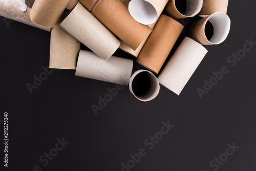 Empty Toilet Rolls Stack Up On a Black Background Canvas Print