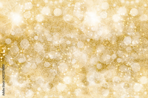 Obraz Golden glittering pattern. Festive background. Shimmering sparkles - fototapety do salonu