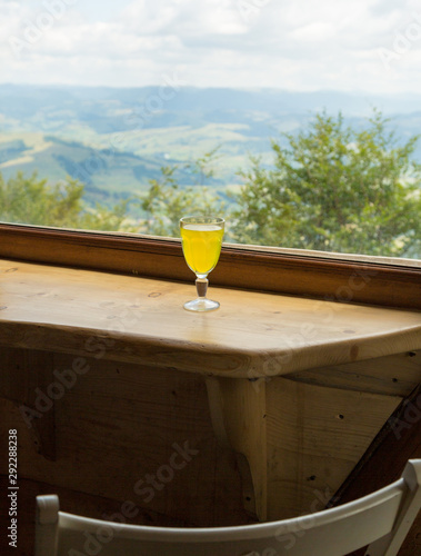 Tea on the background of an open window with mountain views