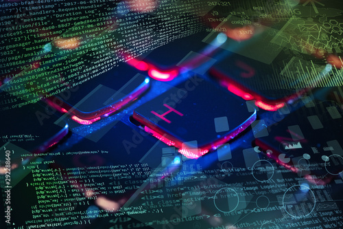 Fotografía  Close-up dark keyboard with coding and programing concept