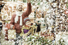 Little Girl With Dad Buying Decorations For Xmas