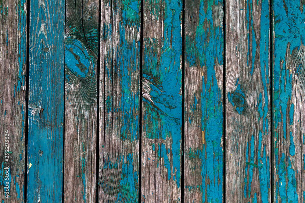 Obraz Old shabby wooden boards with cracked paint, background. Background old wood with large cracks and traces of the remains of old paint fototapeta, plakat