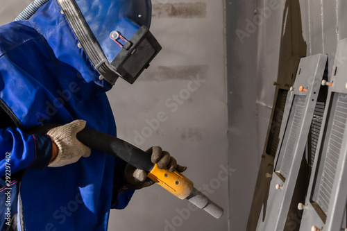 The operator of the sandblasting machine is ready to go Tapéta, Fotótapéta
