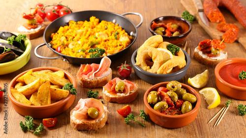 selection of spanish tapas with olive, patatas bravas,calamari,mussel and paella Fotobehang