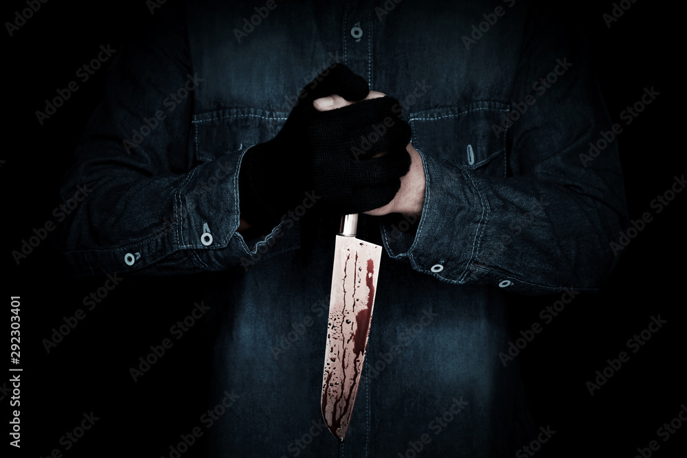 Fototapeta Killer with a bloody knife