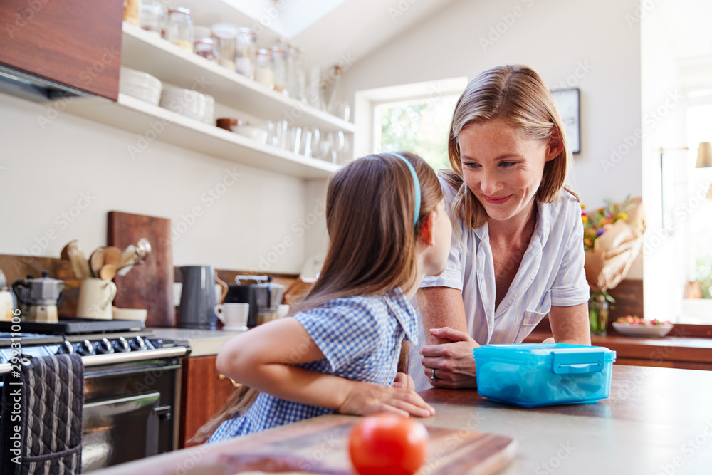 Fototapety, obrazy: Same Sex Female Couple With Daughter Preparing School Lunchbox At Home Together