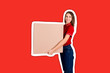 canvas print picture - Beautiful girl is delivering a huge parcel to a customer. Smiling woman in work clothes is holding a box Magazine collage style with trendy color background