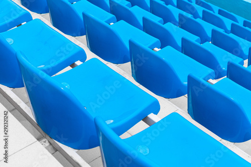 Fotografía Diagonal view of bright blue single seats to watch sport competition