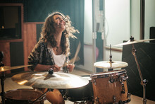 Woman Playing Drums During Mus...