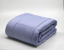 Folded Light Blue Duvet, Isolated On White