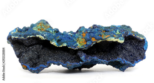 Tiny crystals of dark blue Azurite inside a geode, isolated on a white background Wallpaper Mural