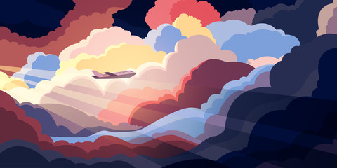 Airplane flying above beautiful clouds in sunset or sunrise light. Travel con...