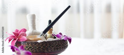 Fotomural  Spa Thai massage accessories in luxury salon on white towel in vase