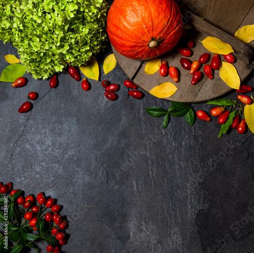 Obraz On an old wooden background on a dark blue plate is a pumpkin orange. Autumn. Harvest. halloween - fototapety do salonu