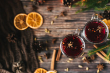 Mulled Wine In Glasses On The Table Decorated With A Christmas Tree. Orange Slices, Anise Stars, Cardamom