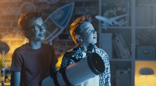 Smart kids using a telescope and stargazing - 292342452