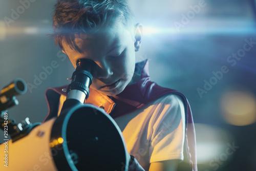 Obraz na płótnie Superhero looking through a telescope