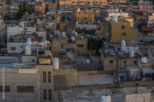 Middle East Arabian ghetto city back streets of houses roofs in Syria after war