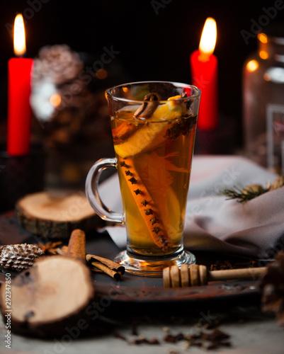 Fototapeta Tea with cinnamon stick, orange and cloves obraz