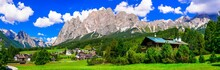 Breathtaking Alpine Scenery, Dolomite Mountains. Beautiful Cortina D'Ampezzo Village, Famous Tourist Destination In Northen Italy