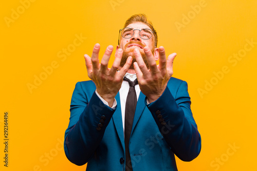 young red head businessman looking desperate and frustrated, stressed, unhappy a Wallpaper Mural