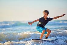 Skilled Teenager Riding Surfboard And Balancing A Long Wavy Sea.