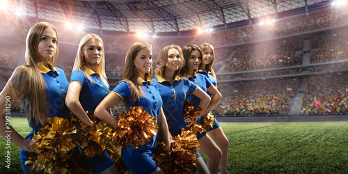 Photo Group of cheerleaders in action on the professional stadium