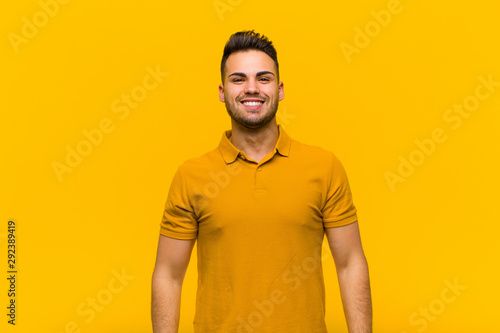 young hispanic man looking happy and goofy with a broad, fun, loony smile and ey Canvas Print