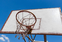 Old And Vintage Basketball Backboard And Blue Sky With Clouds As A Background