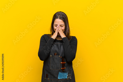 Fotografie, Obraz  hairdresser woman looking happy, cheerful, lucky and surprised covering mouth wi