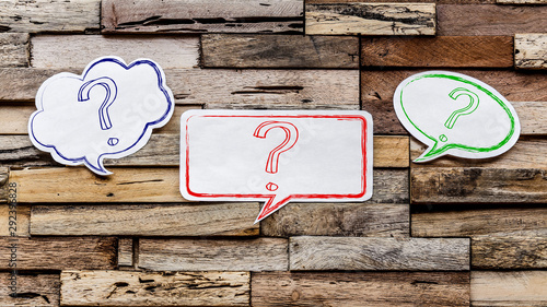 Speech bubbles on wooden background : ? Fototapeta