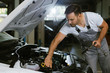 Mechanic working on a car in auto repair shop