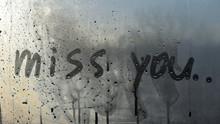 Miss You Text. Inscription On Sweaty Window. Written Message On Steamy Window.
