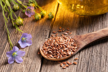 Flax Seeds, Flowers And Oil On...