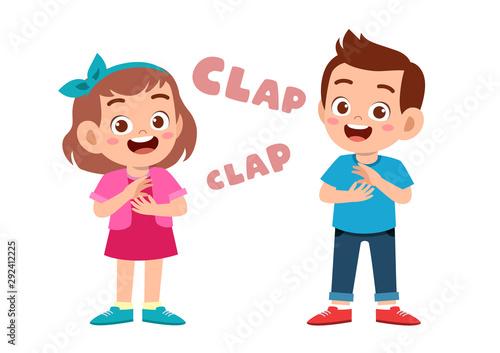 Photo cute happy kid clap hand cheer smile