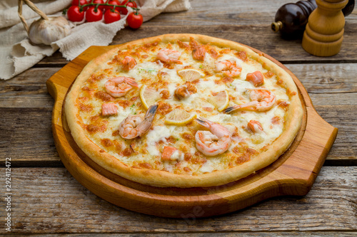 Fototapeta Pizza with seafood on wooden table obraz