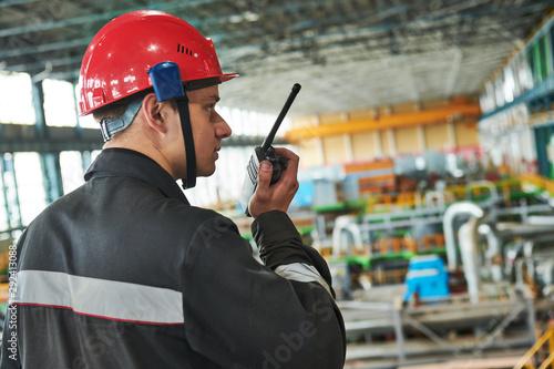 industrial worker on power plant factory with walkie talkie transmitter Fototapet