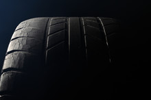 Old Damaged, Worn Black Tire Tread, Large Cracks In The Car Wheel, Tire Black Color For Background.