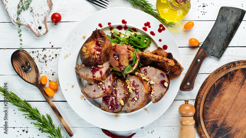Stuffed duck with cranberry sauce. Restaurant dishes. Top view. Free copy space. - 292416694