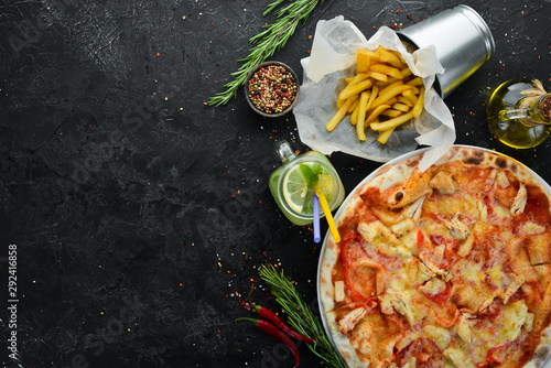 Fast food. Pizza, french fries, sauce, ketchup. Top view. Free copy space. © Yaruniv-Studio