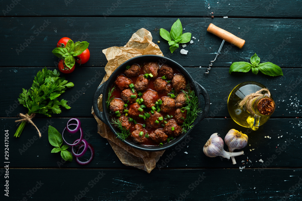 Fototapety, obrazy: Baked meat balls with tomato sauce in a frying pan. Top view. Free copy space.