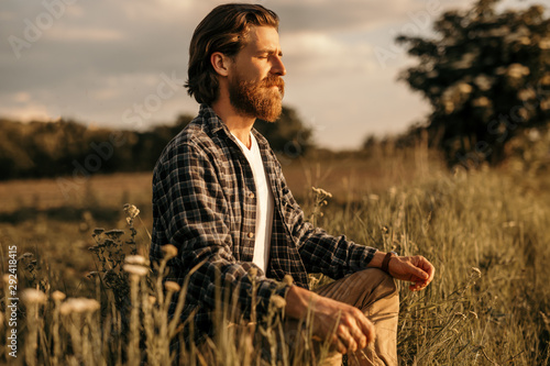 Bearded guy establishing connection with nature