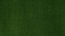 Dark Green Woven Fabric Texture Background. Closeup