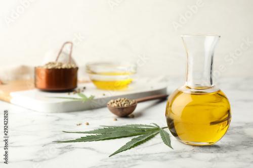 Fototapeta Composition with hemp oil on marble table obraz