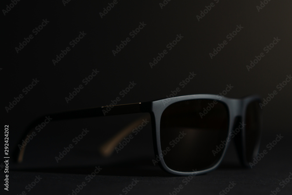 Fototapeta dark sunglasses on black background