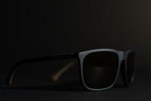Dark Sunglasses On Black Backg...