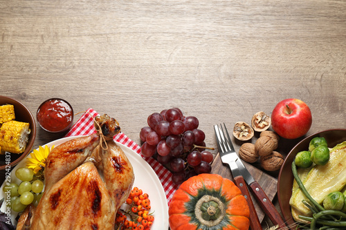 Flat lay composition with turkey on wooden background, space for text. Happy Thanksgiving day