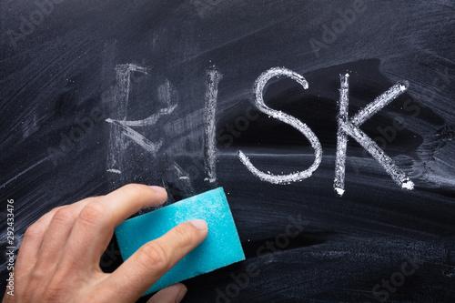 Obraz na plátně Blue Sponge Erasing Risk Word