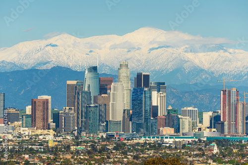 downtown-los-angeles-skyline-with-snow-capped-mountains-behind-at-sunny-day